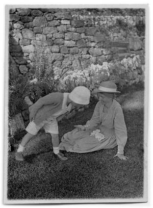 Primary view of object titled '[Child standing next to woman]'.