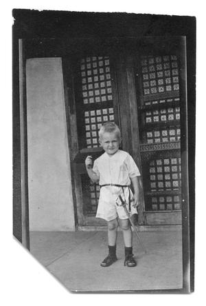 Primary view of object titled '[Boy with toy sword]'.