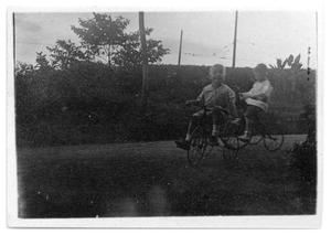Primary view of object titled '[Two children riding bicycles]'.