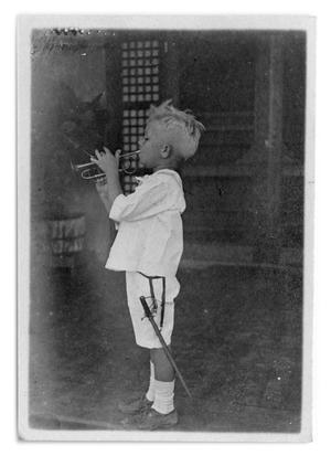 Primary view of object titled '[Boy playing a small trumpet]'.