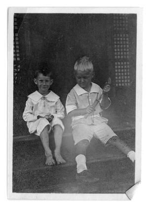 Primary view of object titled '[Two children sitting on steps]'.