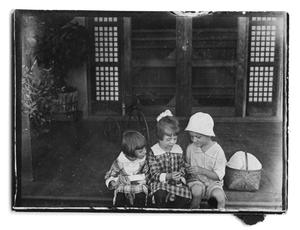 Primary view of object titled '[Three children sitting on a porch]'.
