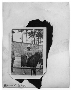 Primary view of object titled '[Child riding a mule]'.