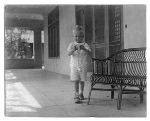 Primary view of object titled '[Child holding a cup]'.