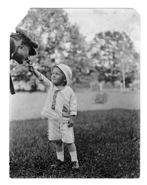 Primary view of object titled '[Boy sharing a flower]'.