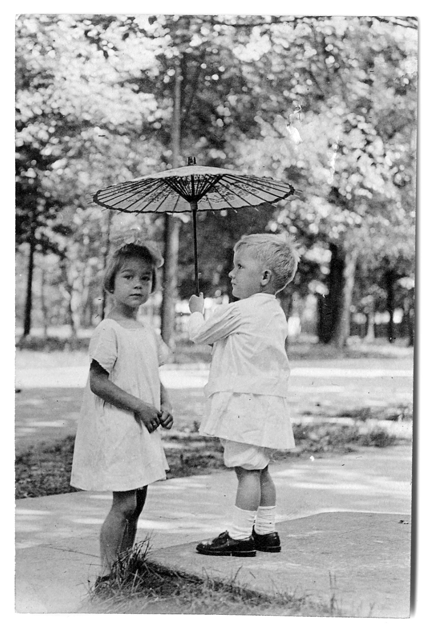 [Boy holding a small umbrella]                                                                                                      [Sequence #]: 1 of 1