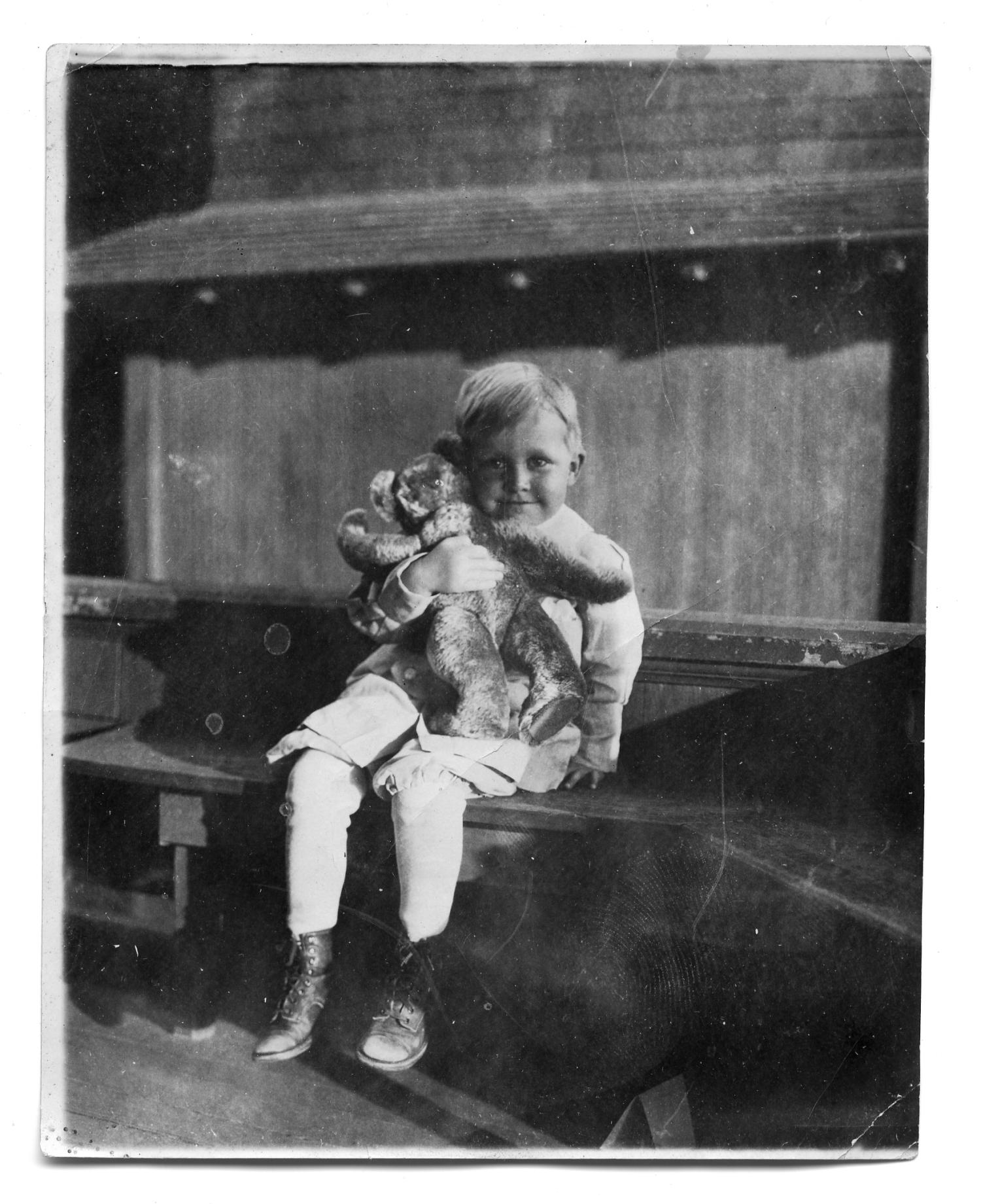 [Photograph of boy holding a bear]                                                                                                      [Sequence #]: 1 of 1
