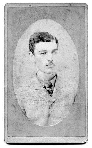 Primary view of object titled '[Oval photograph of young man in striped coat]'.