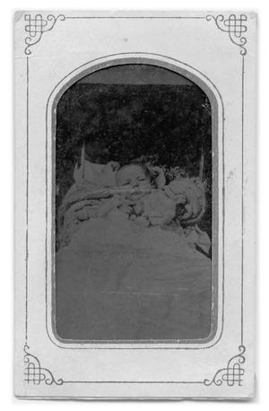 Primary view of object titled '[Tintype of infant in bed]'.