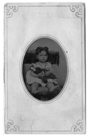 Primary view of object titled '[Small girl holding a doll]'.