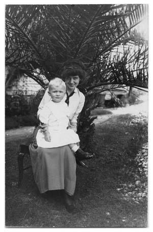 [Young woman holding child]