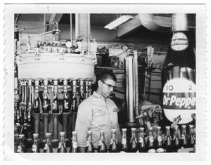 Primary view of object titled '[Man at the Dr. Pepper Factory]'.