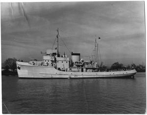 Primary view of object titled '[Navy Tugboat in Water]'.