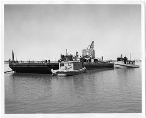 Primary view of object titled 'Barge P9016 with Workers and Tugboats'.