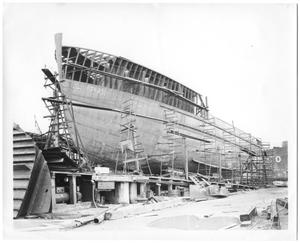 Primary view of object titled '[Photograph of a Tugboat Under Construction]'.