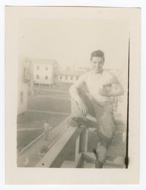 Primary view of object titled '[Man Sitting on a Balcony]'.