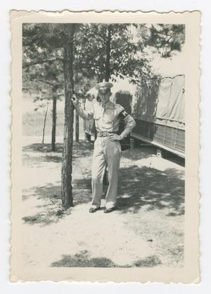 Primary view of object titled '[Military Policeman Leaning on Pine Tree]'.