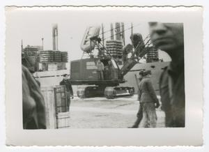 Primary view of object titled '[Crane Loading Supplies onto a Ship]'.