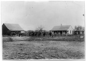 Men on horses in front of a ranch house, Sweetwater, Texas, 1883