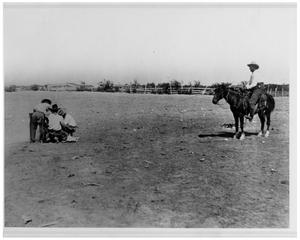 Primary view of object titled 'Roping a Calf on the W Ranch'.
