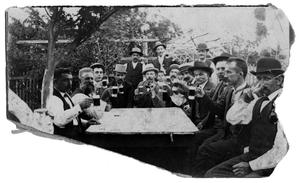 Primary view of object titled '[Group of men drinking outdoors]'.
