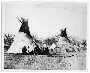 Primary view of object titled '[Indians Sitting Near Teepees]'.