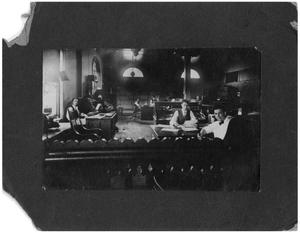 Primary view of object titled '[Men Working in an Office]'.