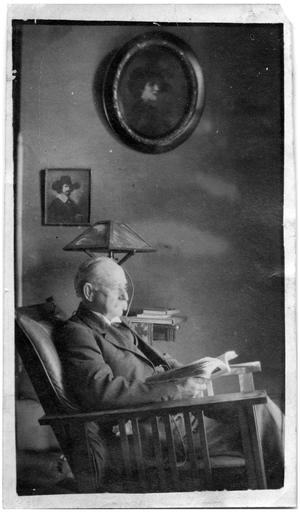 Primary view of object titled '[Man Seated in a Chair, Reading]'.