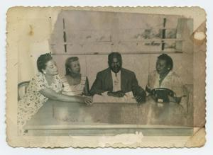 Primary view of object titled '[Group of People at a Table]'.