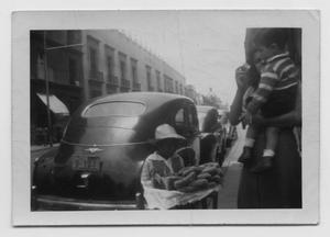 Primary view of object titled '[Boy Selling Pastries in Mexico City]'.