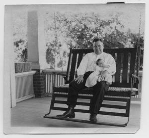 Primary view of object titled '[John T. Willis, Sr. Holding John Todd Willis, Jr.]'.