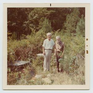 Primary view of object titled '[Pete Vining and Charles C. Smith at the Anthony Garnett Smith, Sr. Cemetery]'.