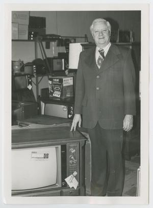 Primary view of object titled '[Frank Greenhaw with Television]'.