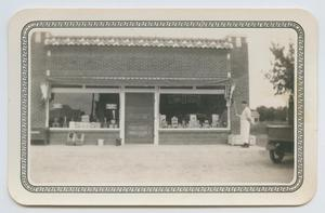 Primary view of object titled '[Ferd Arthur McWhorter at N. A. Holley & Sons Grocery Store]'.