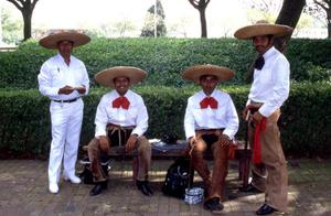 Primary view of object titled '[Four unidentifed in sombreros]'.