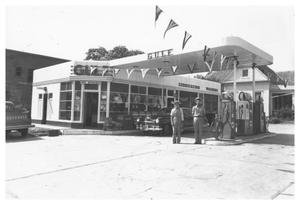 Primary view of object titled '[The Joe Russel Service Station]'.
