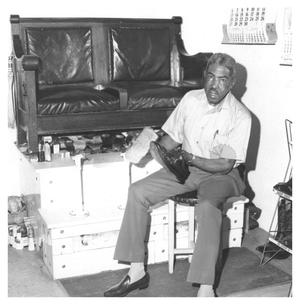 Primary view of object titled '[Leon Cross, Shoe Shine Boy in 1975]'.