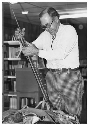 Primary view of object titled '[Elmer Seybold With a Rifle]'.