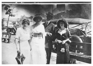 Primary view of object titled '[Three Women and a Man In Front of a Car]'.
