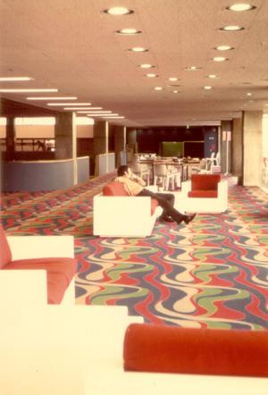 Primary view of object titled '[Cafeteria El Paso Hall with swirled carpet]'.