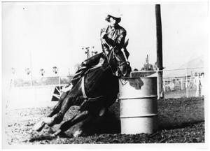 Primary view of object titled '[Cowgirl Barrel Racing]'.