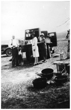Primary view of object titled '[Chuck wagon feeding the crowd]'.