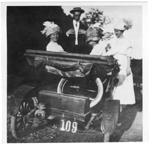 [Kathryn Cass and friends in a red Maxwell car]