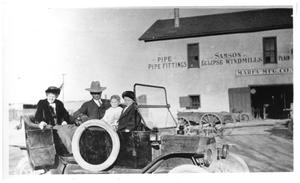Primary view of object titled 'Family in Auto outside Marfa Manufacturing Company'.