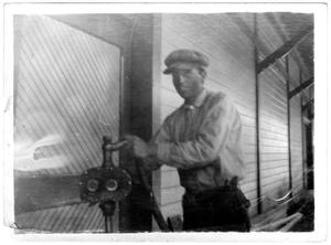 Primary view of object titled 'Van Adams at the Gas Pump, 1914'.