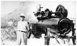 Primary view of object titled '[Wayne Cartledge standing besided restored engine and boiler in Castolon]'.