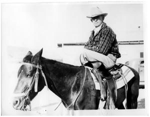 Primary view of object titled '[Wayne Cartledge is riding his horse in Castolon]'.