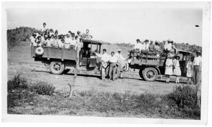 Primary view of object titled '[Jose Cenicero transports school children on two trucks for a picnic]'.