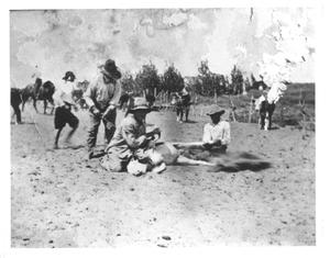 Primary view of object titled '[Branding calves at the McElroy or Y Ranch]'.