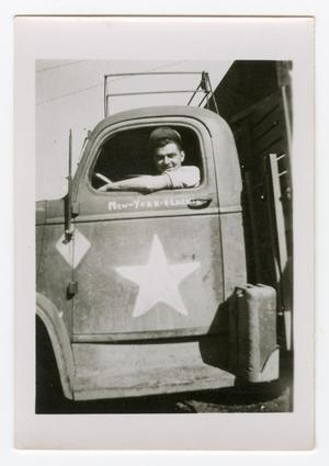 Primary view of object titled '[Elmer Heinlein in a Water Truck]'.